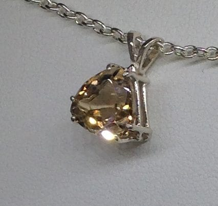 Imperial Topaz Trillion set in a Sterling Silver Pendant