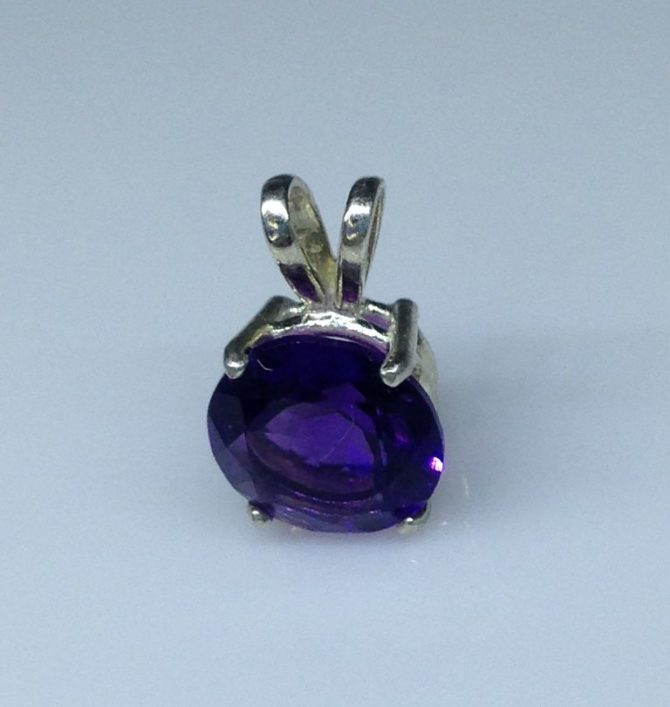 Round Amethyst Gem set in a Sterling Silver Pendant