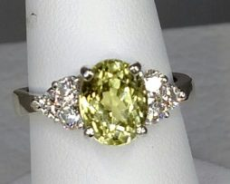 Peridot AZ 10x8 Oval Topaz Accents Sterling Ring