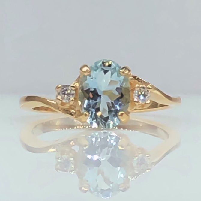 Aquamarine blue oval colorado yellow gold