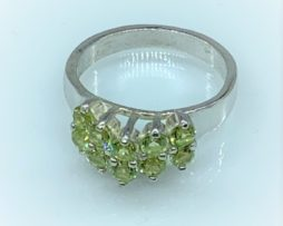 Ten Colorado Peridot Aligned in a Sterling Silver Ring